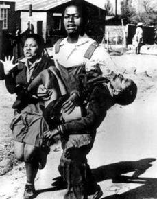 Sam Nzima's photo MM carrying HP with his sister Antoinette Pietersen 1976