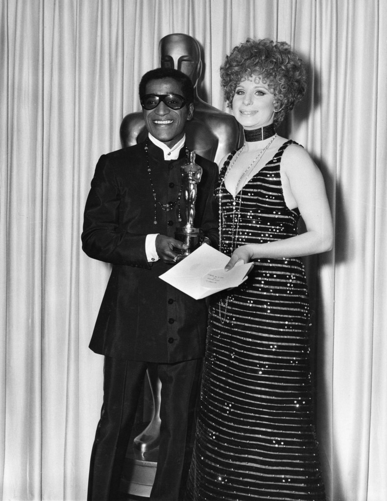 Sammy Davis Jr accepts Leslie Bricusse's Best Song Oscar from Barbra Streisand for Talk to the Animals from Doctor Dolittle