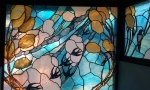 Stained glass window, swallows.