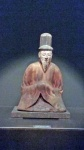Seated male Shinto deity.
